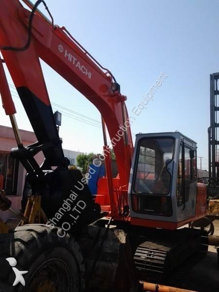 Vedeţi fotografiile Excavator Hitachi EX100 EX100