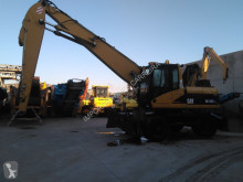 Caterpillar M 318 C MH pelle de manutention occasion
