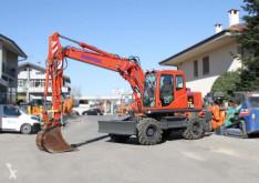 Komatsu pw130-7k excavator pe roti second-hand