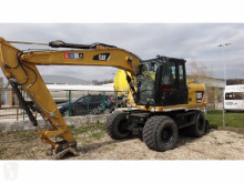 Caterpillar excavator pe roti second-hand