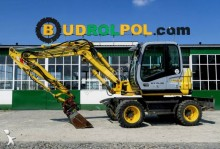 New Holland MH 2.6 excavator pe roti second-hand