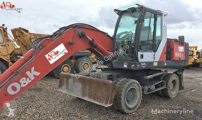 View images O&K MH 5.5 excavator