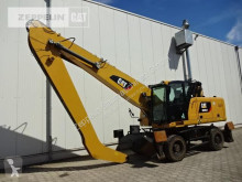 Caterpillar MH3024 excavator pe roti second-hand