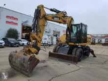 Caterpillar M313 excavator pe roti second-hand