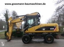 Caterpillar M 318 D excavator