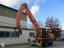 Doosan DX210 W DX210WMH pelle de manutention occasion