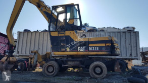 Caterpillar M318 pelle de manutention occasion