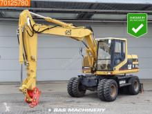 Caterpillar M312 skovel på däck begagnad