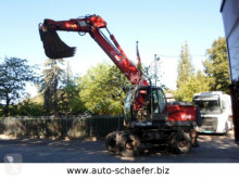 O&K MH 6.5/ MOBIL excavator pe roti second-hand