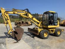 Komatsu PW95 escavatore gommato usato