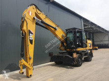 escavatore per movimentazione Caterpillar