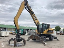 Pelle sur pneus Caterpillar CAT M318D
