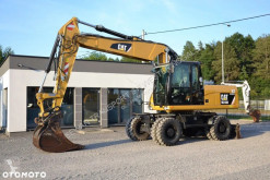Caterpillar M318 D excavator pe roti second-hand