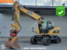 Caterpillar M316 excavator pe roti second-hand