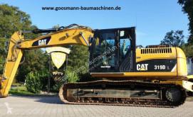 Caterpillar 319 DL pásová lopata použitý