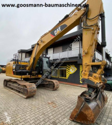 Caterpillar 323 EL pásová lopata použitý