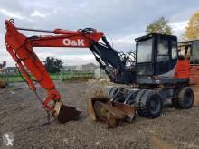 O&K escavatore gommato usato
