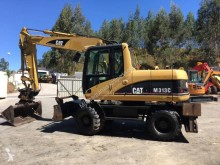 Caterpillar M313C excavator pe roti second-hand