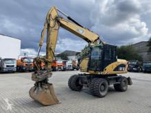 Gravemaskine på hjul Caterpillar M313D Mobilbagger *11.400 h *Hammerleitung