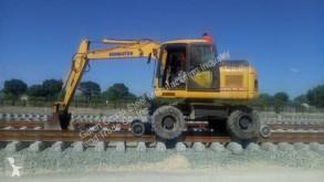 Koparka szynowo-drogowa Komatsu Railway Friction Drive System