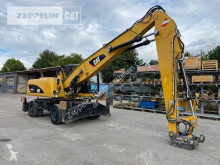 Caterpillar M318DMH materialhanterare begagnad