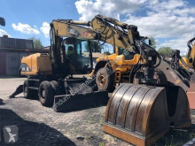 Caterpillar M316C excavator pe roti second-hand