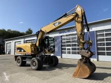 Caterpillar M318D Mobilbagger *12.165 h *Hammerleitung skovel på däck begagnad