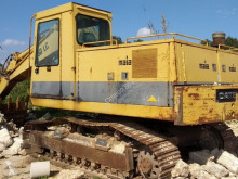 Caterpillar 215DLC excavator pe şenile second-hand