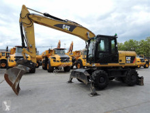 Skovel på däck Caterpillar M315