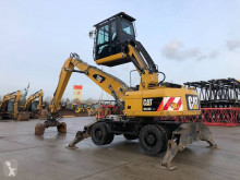 Caterpillar M318 excavator pe roti second-hand