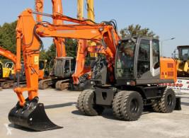 Escavatore gommato Hitachi ZX140W-3