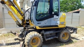 New Holland pelle sur pneus occasion