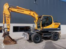 Hyundai Robex 140 W-9 A excavator pe roti second-hand