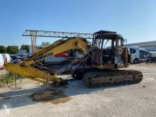 Komatsu PC 138 US excavator pe şenile accidentată