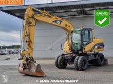 Caterpillar M313C excavator pe roti second-hand