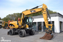 Caterpillar 316C excavator pe roti second-hand