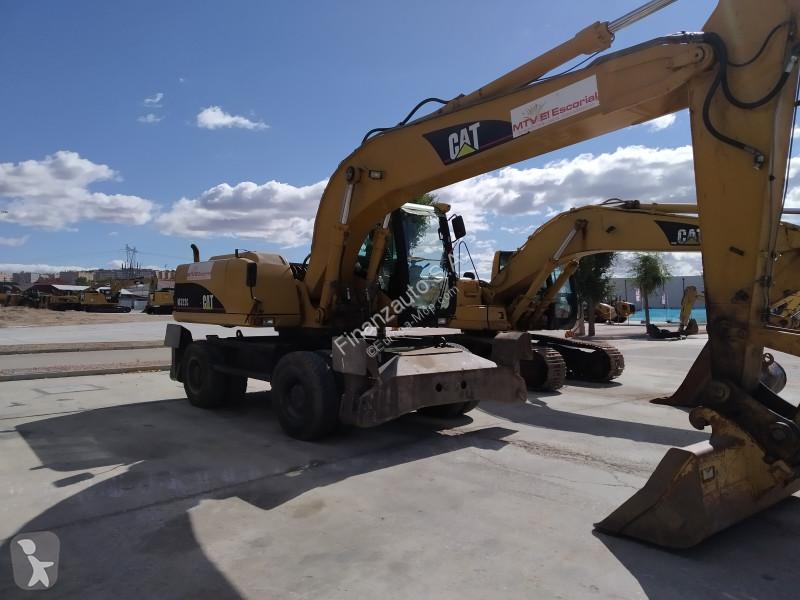 View images Caterpillar M322CIM excavator