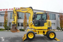 Komatsu PW118MR-8 13,5t , broken/tipping arm , joystick ,q/c , blade , supports tweedehands graafmachine op banden