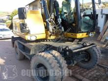 Caterpillar M316D excavator pe roti second-hand
