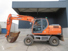 Doosan DX 140 W excavadora de ruedas usada