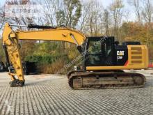 Caterpillar 323FL pásová lopata použitý