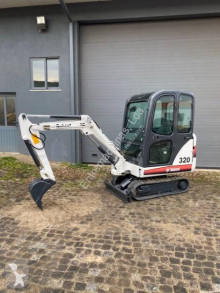 Bobcat X 320 mini-escavadora usada