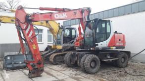 Экскаватор колёсный O&K MH Plus