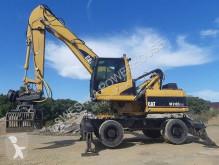 Escavadora escavadora de rodas Caterpillar 318C MH koparka przeładunkowa