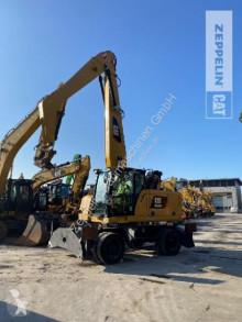 Caterpillar wheel excavator MH3022