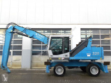 Fuchs MHL320 pelle de manutention occasion