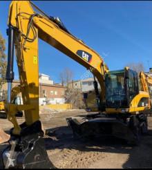 Excavadora Caterpillar M318D(1047)(FD) excavadora de ruedas usada