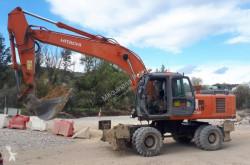 Hitachi ZX210W excavator pe roti second-hand