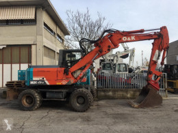 O&K MH CITY excavator pe roti second-hand