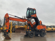 Doosan DX 210 W-5 excavator pe roti second-hand